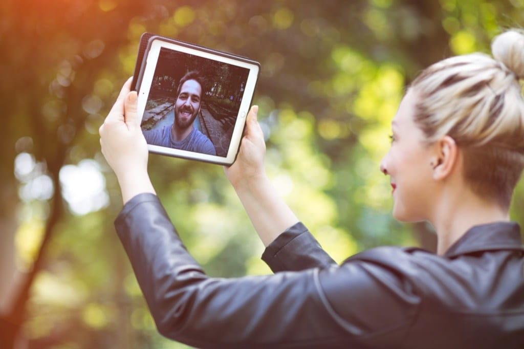 Woman Man Ipad Talking Long Distance Relationships