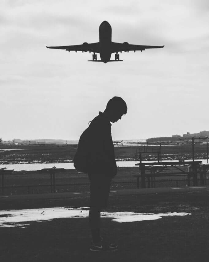 Plane Flies Over A Man In A Long Distance Relationship